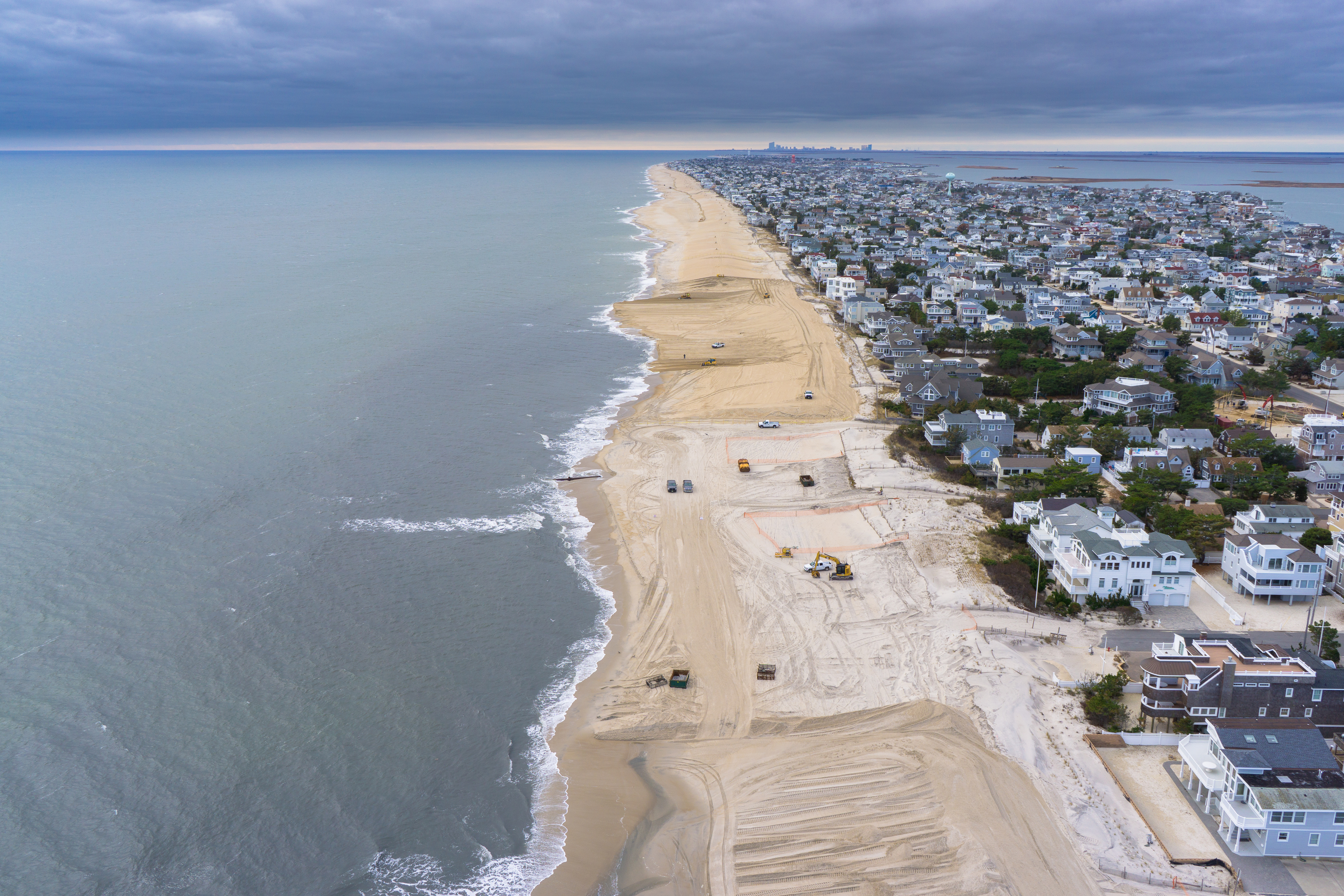A photo of the Philadelphia District pumping sand onto Brant Beach, N.J., in 2013.