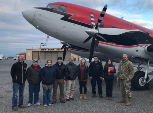 A photo of the JALBTCX team standing in front of their aircraft at Long Island MacArthur Airport in Ronkonkoma, New York.